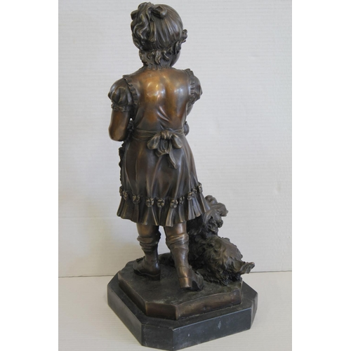 638 - A Bronze Study of a Young Girl holding 2 puppies & a dog by her side on a marble Base. Measuring: 52...