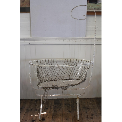 648 - A Regency Design Wrought Iron Babies Cot with twisted stem.