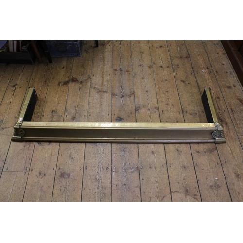 651 - An Edwardian Brass covered Fender. Measuring: 138cms Long x 40cms deep.