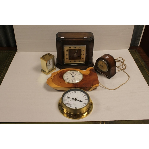 171 - An Art Deco Oak Cased Mantel Clock along with a Temco Electric Clock, Carriage Clock & 2 others.