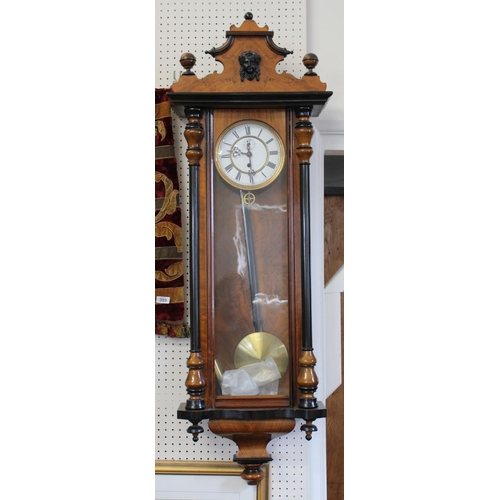 174 - A Late 19th Century Wall Clock with White enamelled dial, second sweep, blued hands, twin column, ke...