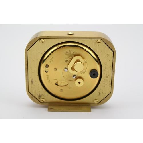 175 - A 1960s Angelus brass cased alarm clock, no: 1221.