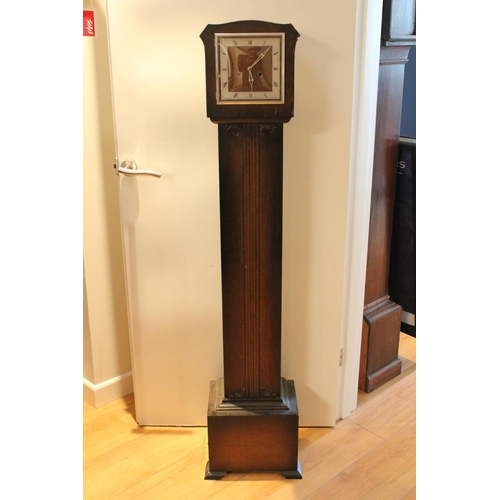 178 - A Oak Cased Grand Mother Clock with a Brass & Nickel Face with Key.
