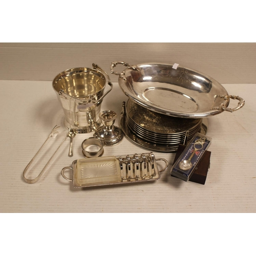 35 - A Silver plated ice bucket, tongs, toast rack, dish, etc....