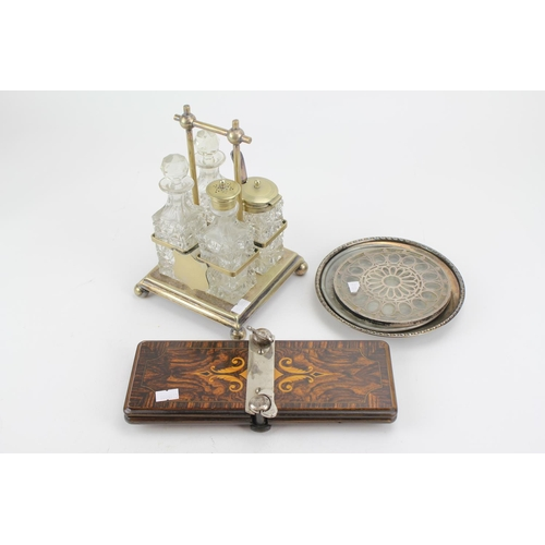 44 - A Four Bottled Silver Plated Cruet Set, Silver Mounted Tea Pot Stand, a Tie Press, etc....