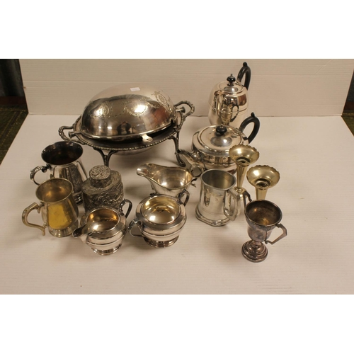 48 - A collection of Silver Plate to include a 4 Piece Plated Tea Set, a revolving breakfast dish, along ...