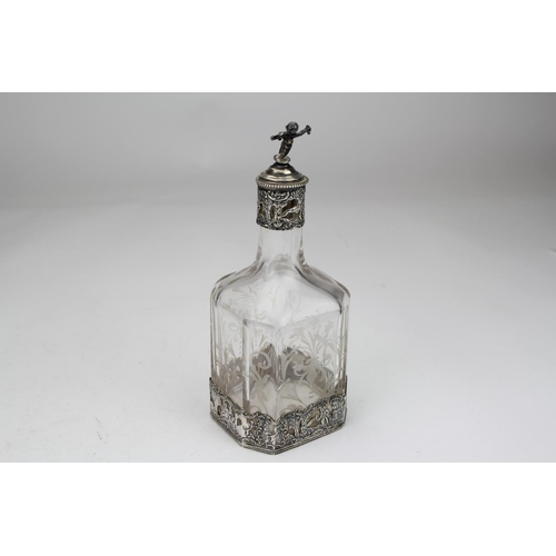 10 - A Silver Dutch import marked liquor bottle with figures in a landscape scene with a cork and cupid s...