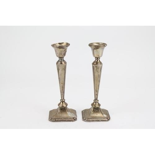20 - A Pair of Sheet Silver Candlesticks. (AF)....