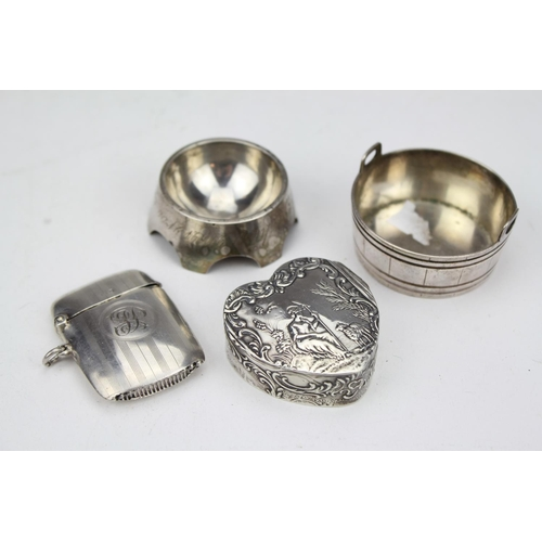 23 - A Dutch Silver box embossed with figures on a landscape, a Russian salt, one other and a Silver vest...