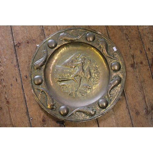 576 - A large Art Nouveau brass fish embossed charger after Newlyn.