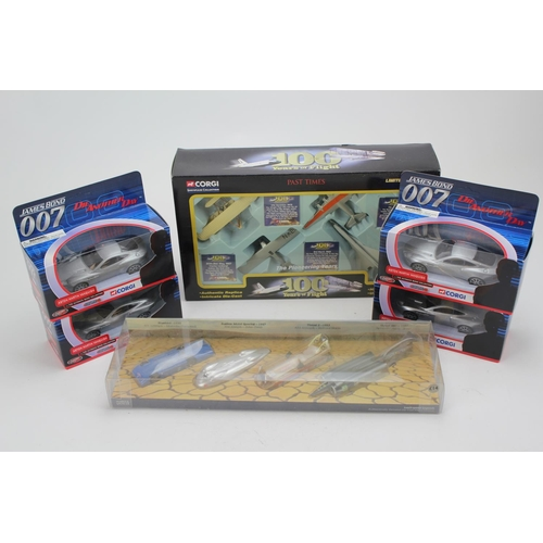 10 - A Box of models to include: 4 x Boxed TY07501 James Bond Aston Martin Models, a 4 Piece World Record...