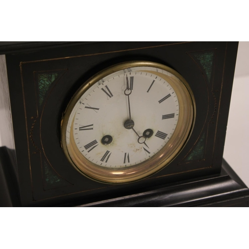196 - A Late 19th Century Malachite & Slate Drawing Room Clock with enamelled Dial & Key.