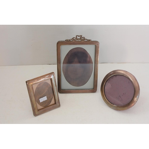 24 - Three Silver mounted photograph frames with ribbon and bow decoration.