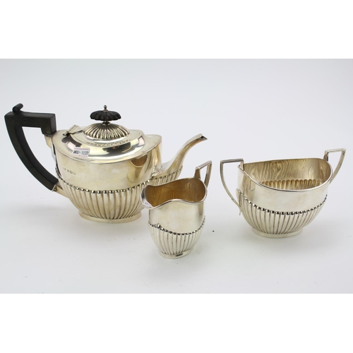 33 - A Three Piece Silver tea set with fluted decoration, Birmingham D, weight 654 grams.