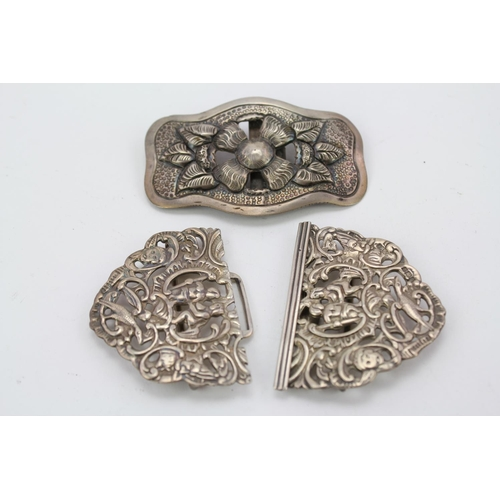 34 - A Victorian Silver nurses buckle and a Japanese buckle.