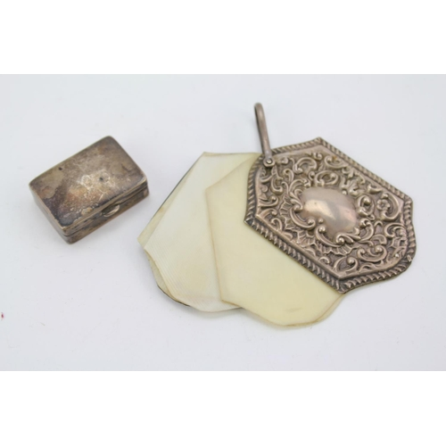 35 - A Victorian Silver chatelaine, aide memoire and a Silver pill box.