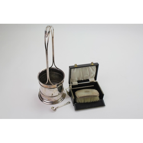 """4 - A """"Roberts & Belk"""" silver plated champagne holder and a silver backed hair brush."""