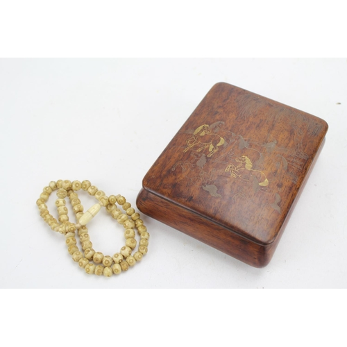 205 - A Japanese Hardwood Box decorated with Horses along with an Ivory Bead Necklace.