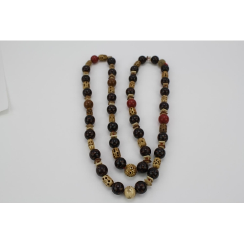169 - A Chinese Bead Bone and Lacquered Necklace.