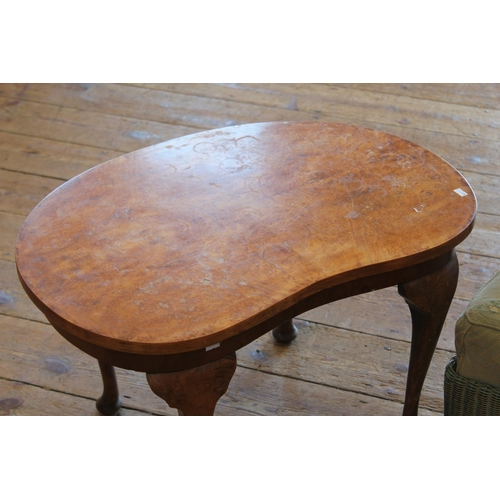 322 - A Lloyd Loom chair resting on pad feet along with a kidney shaped table.