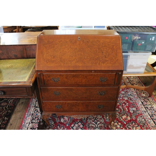 328 - A Bureau with 3 Graduated Drawers, Carved Legs & Fitted interior. Measuring: 101cms high x 75cms wid...