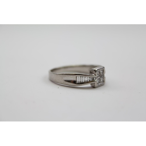 53 - A Ladies Diamond Set Ring, mounted with baguette diamonds in 18 carat white gold. Weighing: 8.4 gram...