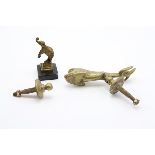 557 - A Bronze Desk Seal designed as an elephant and a fish door knocker.