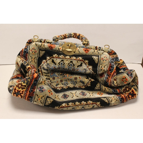 303 - A Carpet Bags of England holder in various colours.