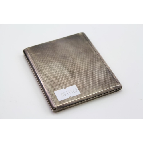 13 - A Silver Engine Turned Sliding action cigarette case, 1937. Weight approx 108 grams.