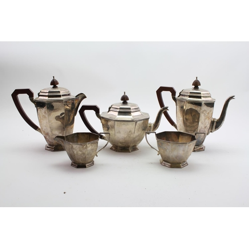 15 - A Five piece Hexagonal shaped tea and coffee service with hot water jug, ebony handles. Weight: appr...