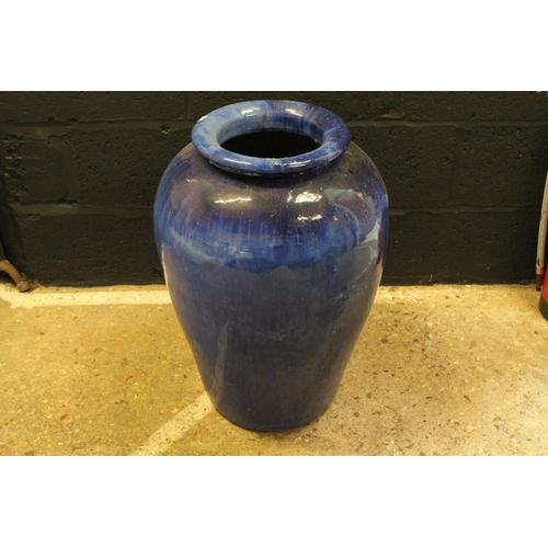553 - A Large blue glazed terracotta garden pot. Measuring: 43 cms x 65 cms.