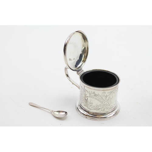 21 - A Victorian Silver Mustard Pot with Spoon with engraved decoration. Weight 110 grams.