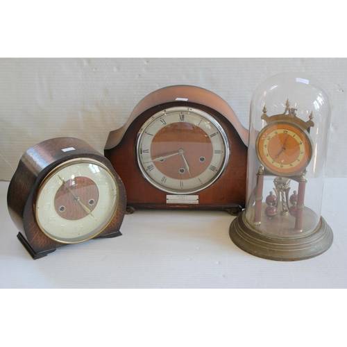 228 - An Anniversary clock under glass dome & two oak cased mantle clocks.