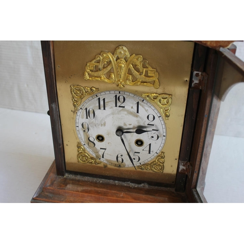 229 - An Edwardian oak cased drawing room clock with brass chapter ring.