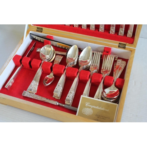 42 - A Canteen of Silver plated cutlery in a Wooden Case.