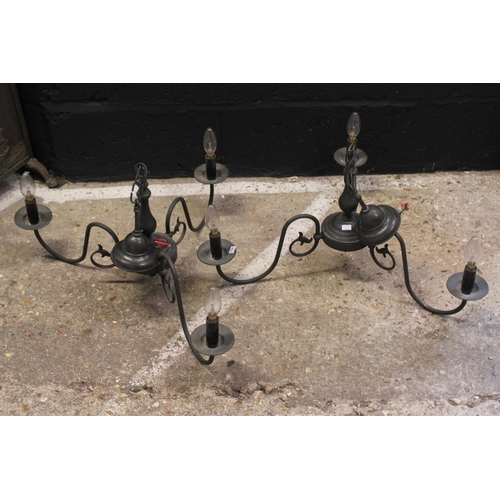 546 - Two black painted 3 light Chandeliers.