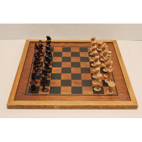 223 - An African Hardwood Yoruba design Chess Board with Figurative Chess Pieces.