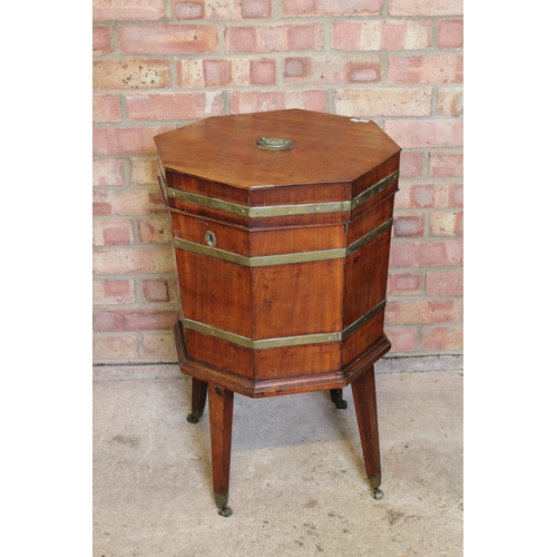 343 - A Georgian period Gillows design Mahogany Hexagonal Wine Cooler on stand with brass banding, resting...