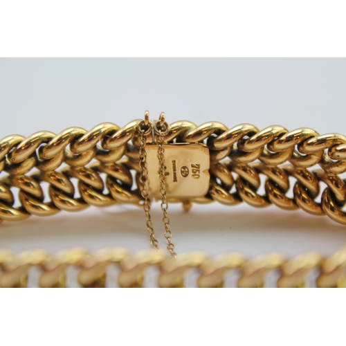 90 - A Beautiful Ladies 18 carat Gold Swiss made bracelet with safety catches. Weight approx 51 grams. It...
