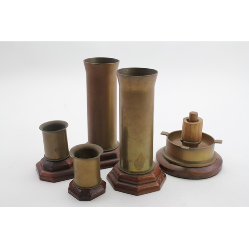 265 - A Cigarette Lighter made from the Brass Shell Case of a 1943 Shell along with two shell case vases, ...