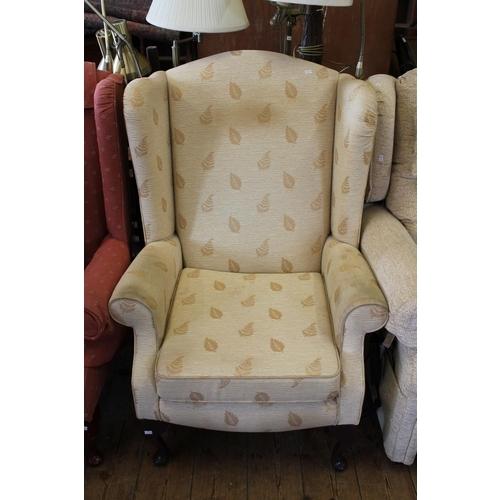358 - A Gentleman's Semi-winged Fireside Chair in Moquette.