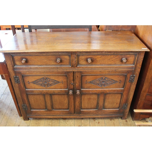 379 - An Oak Sideboard with fitted 2 x drawers and cupboards below. Measuring: 120 cms wide x 44 cms deep ...