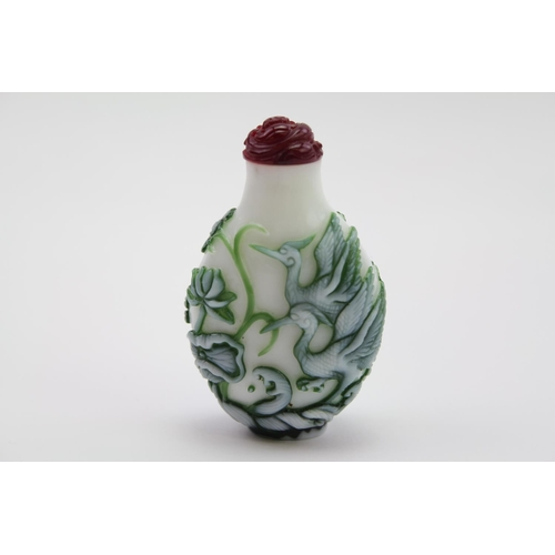 184 - A Peking Glass White & Green Overlaid Scent Bottle decorated with a Flying Stork. Measuring: 7 cms h...