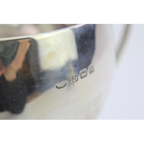 31 - An Art Nouveau Silver Three Handled Loving Cup with Whiplash Handles. Weighing: 343 grams.