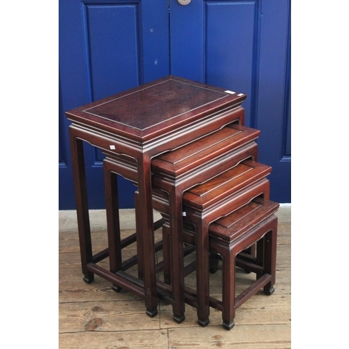 174 - A nest of four graduated Chinese hardwood tables with line beaded decoration and inset top.