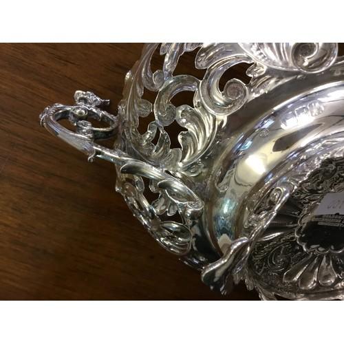 17 - A Silver twin handled Dutch design cake basket,