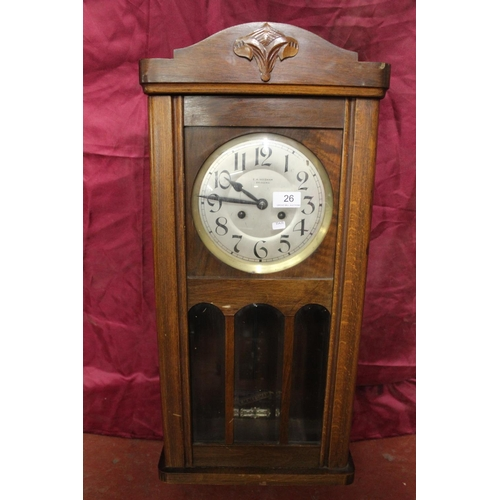 26 - VINTAGE 2 HOLE WALL CLOCK WITH DIAL BY E.M. NEEDHAM BRIDGEND (KEY & PENDULUM IN OFFICE)