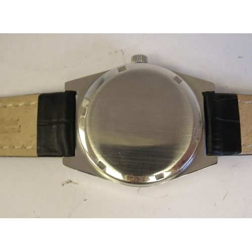 39 - A 1970s Omega Genève stainless steel cased wristwatch, the movement with sweeping seconds, faced by ...