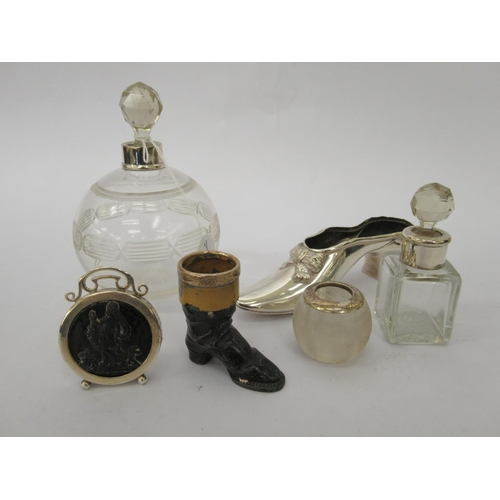 41 - Silver items, viz. a hatpin cushion frame, in the form of a shoe; a black boot vesta holder with a s...