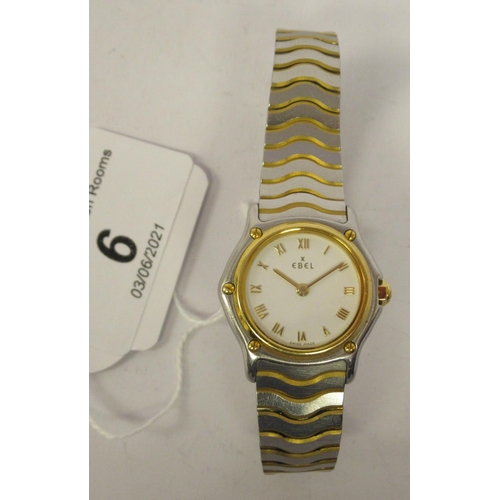 6 - A lady's Ebel bi-coloured stainless steel cased bracelet wristwatch with an 18ct gold bezel, faced b...